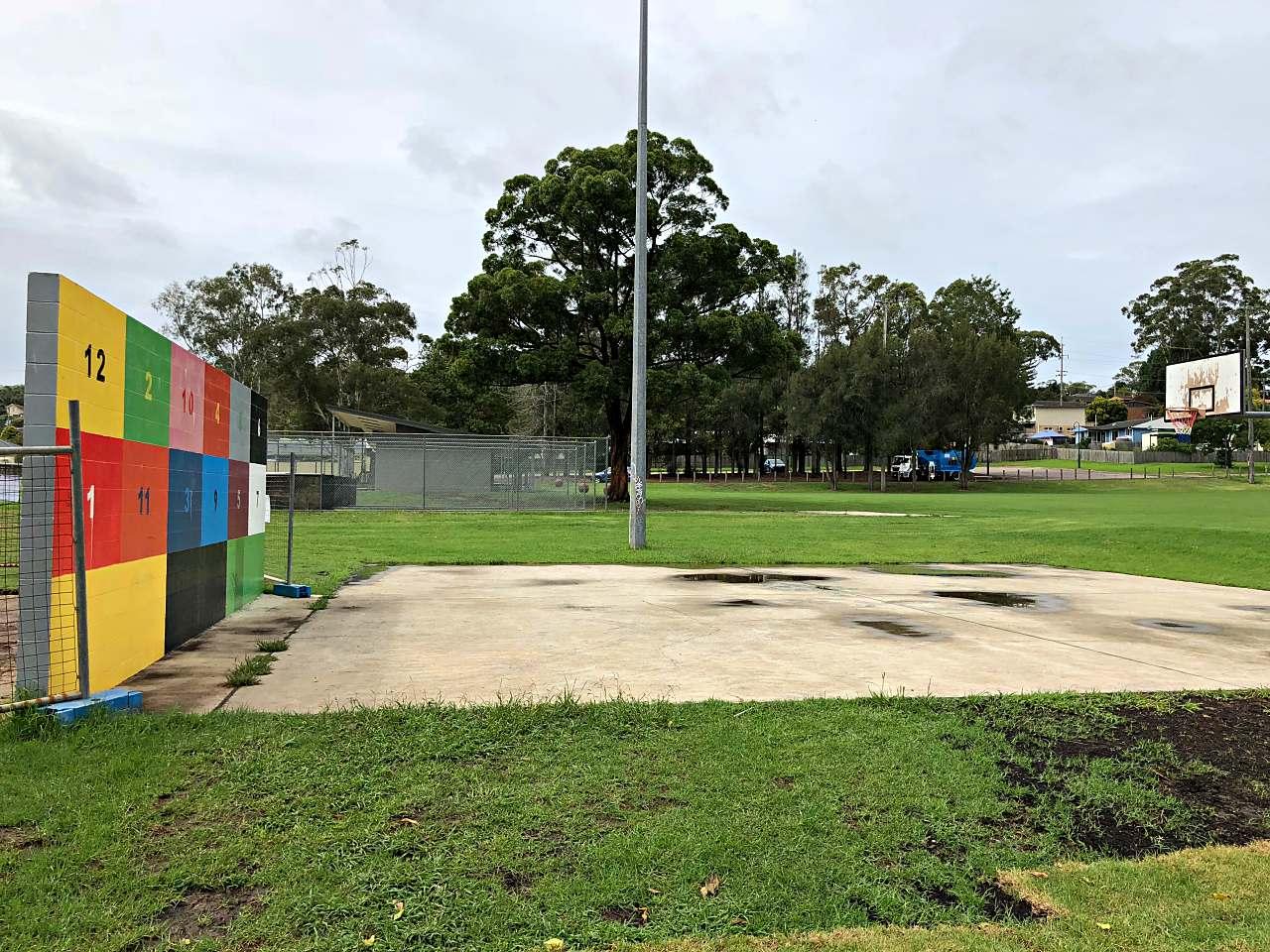 Kickwall and basketball hoop at Alan Davidson Oval playground
