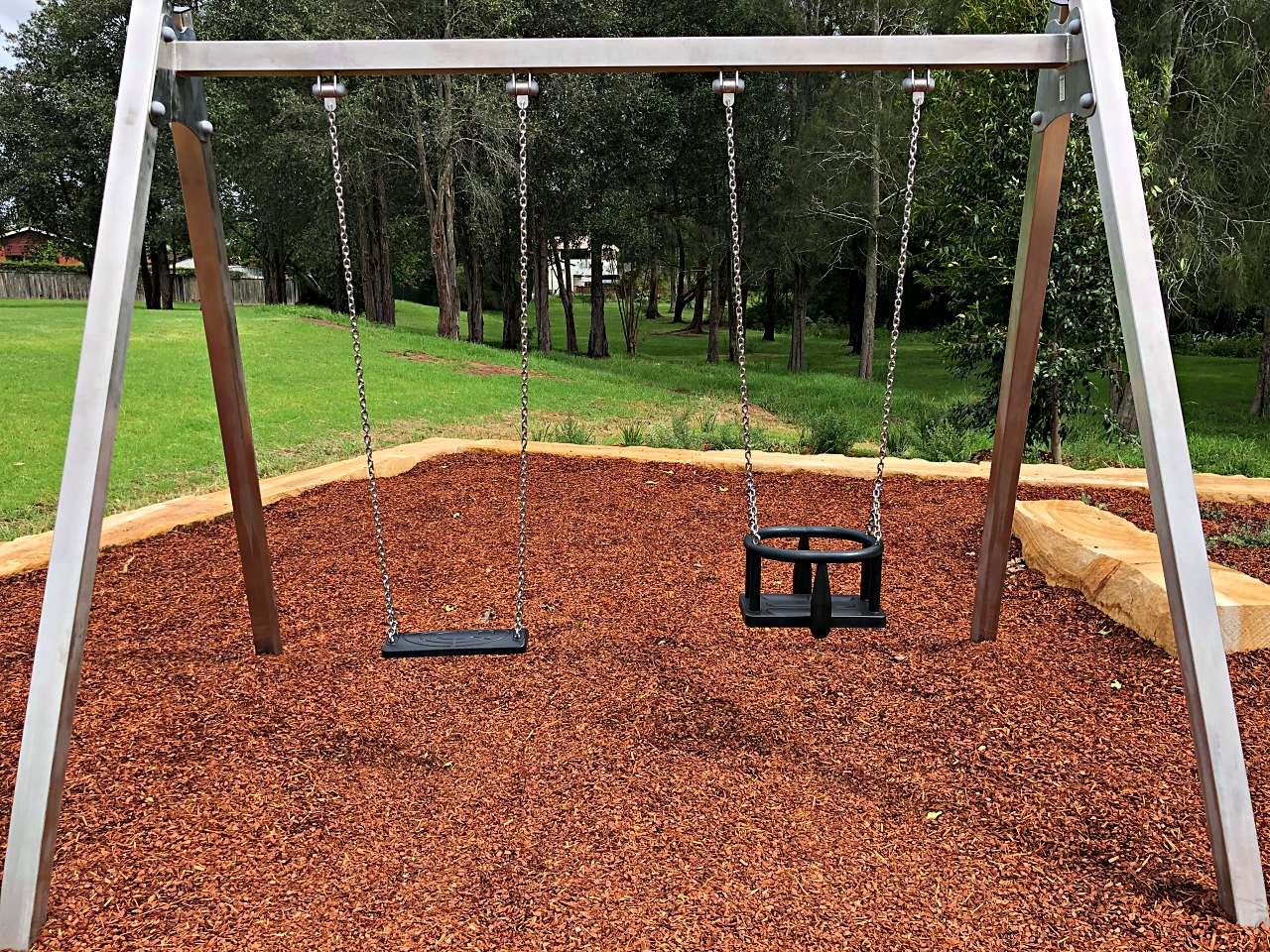 Swings at Alan Davidson Oval playground, Wyoming